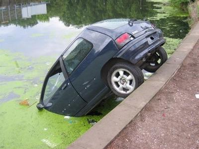 Car in pond.