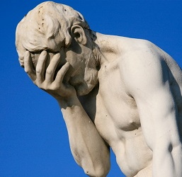 Statue doing a face palm.