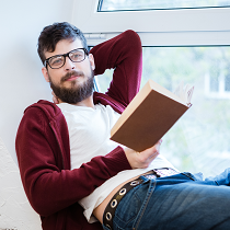 Young bearded man with book