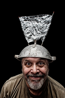 Man wearing hat made from a colander and tinfoil