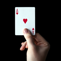 A hand holding an ace of hearts playing card.