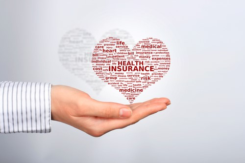 Health insurance heart above hand