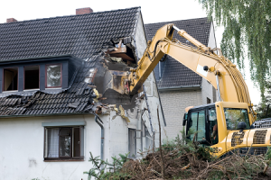 A digger wrecking a house