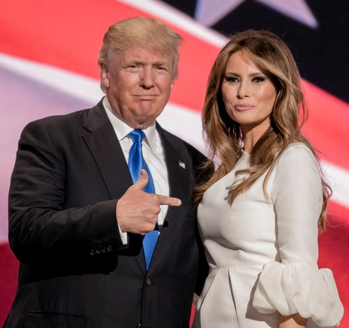 Donald Trump pointing at Melania Trump's chest